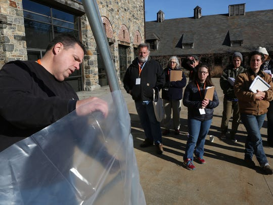 Adam Lemieux of Johnny's Selected Seeds shows how to construct a movable greenhouse during the 7th annual Young Farmers Conference at Stone Barns Center on Dec. 4.