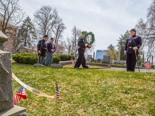 From lef: Sean Protas, Ken Chew, George McDowell and James Hanby participate in the wreath-laying ceremony.