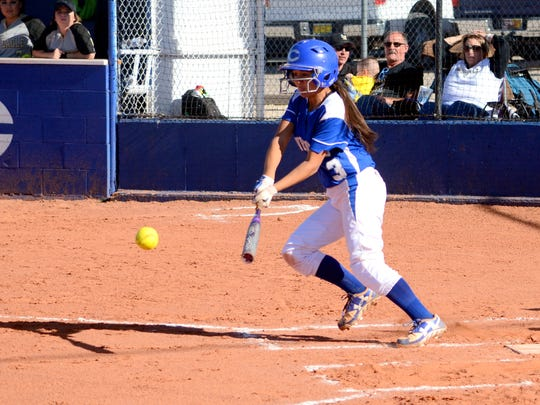 Carlsbad's Marissa Reyes makes contact at the plate in game one against Hobbs.
