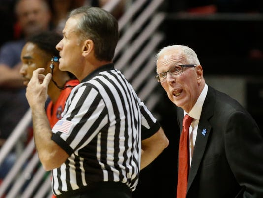 FILE - In this Nov. 13, 2015, file photo, San Diego State coach Steve Fisher speaks to the referee in the first half of a NCAA college basketball game against the Illinois State in San Diego. Two people with knowledge of the situation said Monday, April 10, 2017, that Fisher is retiring after spending 18 seasons as San Diego State's basketball coach. (AP Photo/Lenny Ignelzi, File)