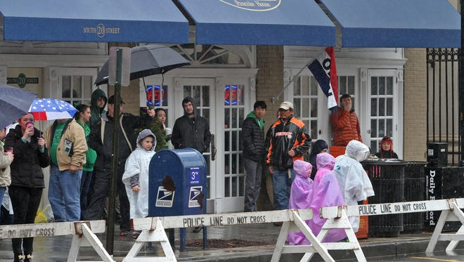 Rain dampens the revelry at a parade in Morris County.