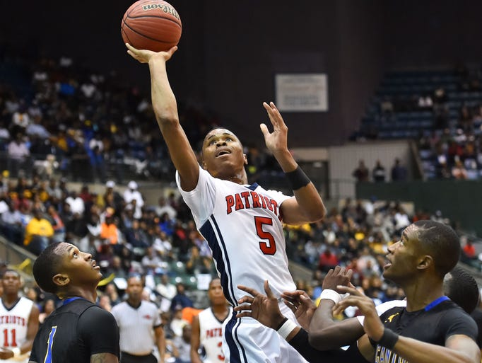 Forest Hill's Keondre Montgomery (5) shoots against