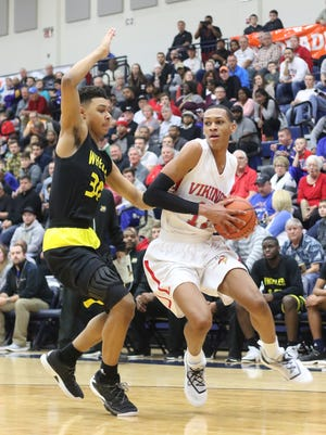 Princeton's Darius Bazley drives to the basket  during the Vikings' Flyin' to the Hoop game against Wheeler, Monday, Jan. 16, 2017.