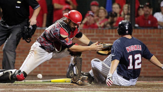 UL catcher Michael Strentz (11) drops the ball allowing Ole Miss' J.B. Woodman (12) to score during the Rebels? 10-4 win over the Cajuns.