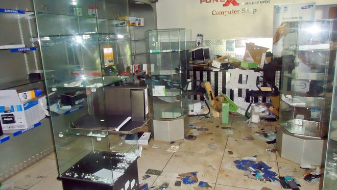 The scene inside the FoneXpress computer shop on the ground floor of the Westgate Mall in Nairobi, Kenya, after the terrorist attack.