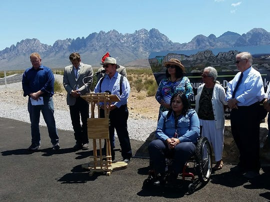 Rabbi Larry Karol of Temple Beth-El, at the lectern, leads a group of elected officials in a benediction on Monday, July 11, 2017, during a news conference in support of maintaining the current size of Organ Mountains-Desert Peaks National Monument.