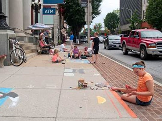 Participants get started creating their art in front of PNC Bank on Carlisle Street in Hanover.