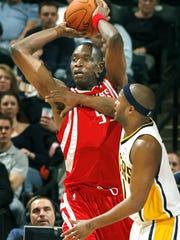 Houston Rockets' Dikembe Mutombo is shown playing the