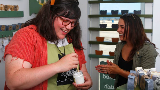 Amy Bergman, owner of Big Spoon Little Spoon Naturals, helps a customer at her store in Asbury Park.