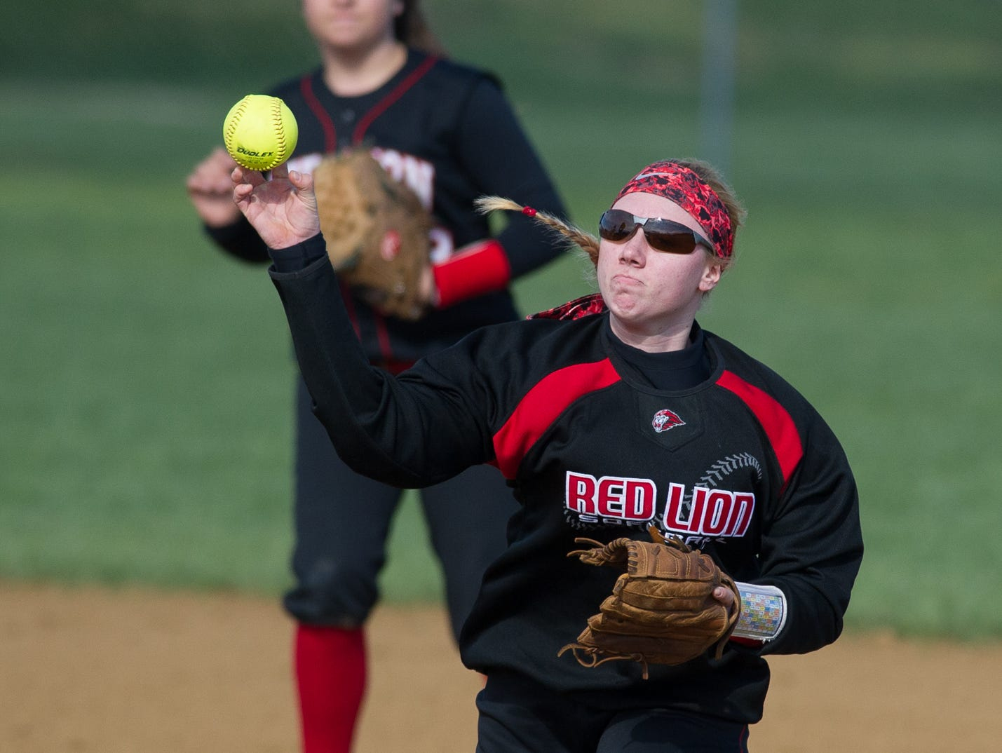 Red Lion's Taylor Beres (25) makes a throw to home plate in their game against Lake Forest.
