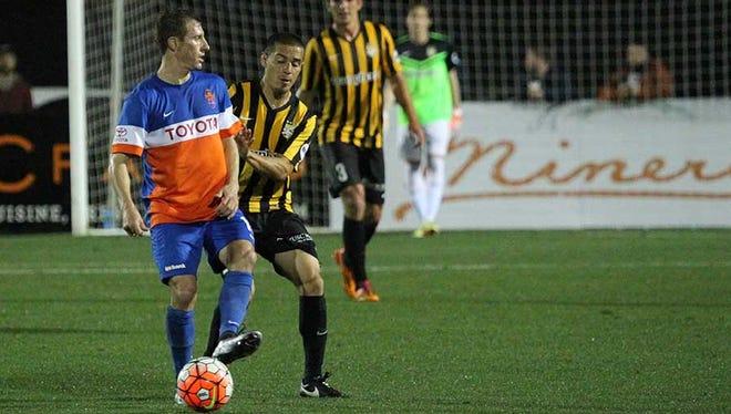 FC Cincinnati midfielder Corben Bone receives a pass during the team's March 27, 2015, 1-0 loss at Charleston Battery.