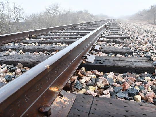 Railroad tracks west of Wichita Falls disappear into