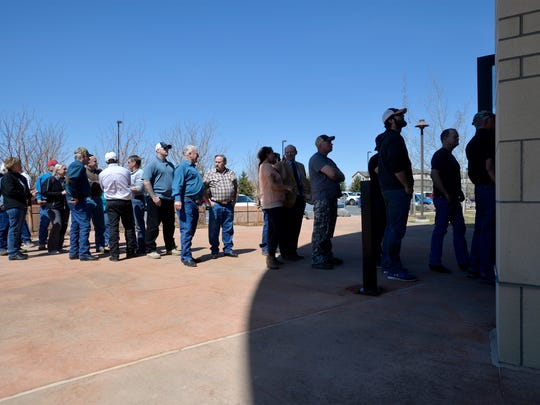 People wait in line to get into the Missouri River Federal Courthouse on Thursday to attend a hearing on a lawsuit by environmental groups involving pallid sturgeon and a dam on the Yellowstone River.  People from communities like Sidney rely on the diversion of water from the Yellowstone River to farm and for drinking water.