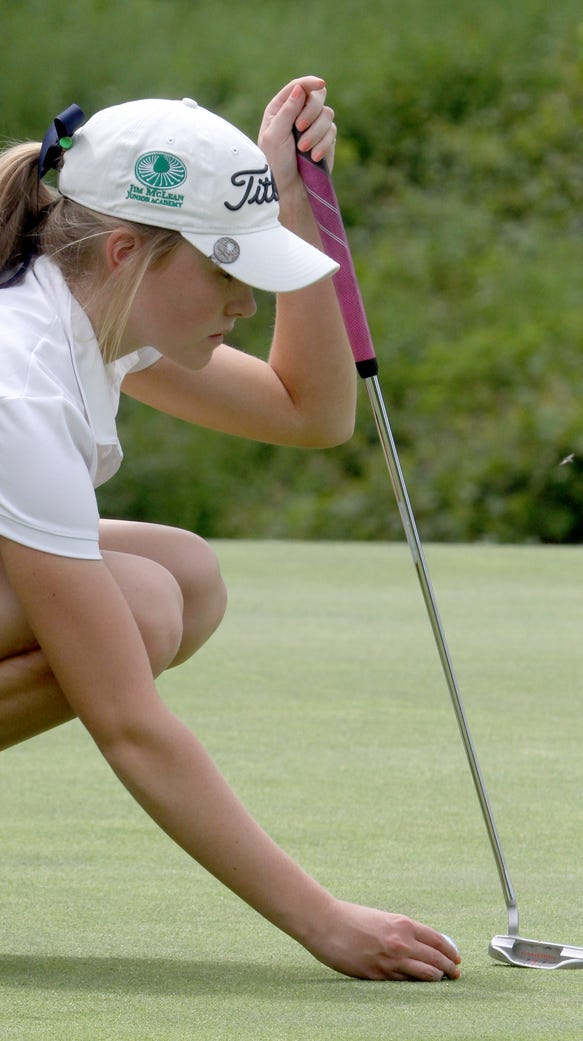 Caroline Hodge of Ursuline places her ball on the 15th