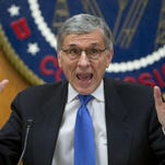 FCC Chairman Tom Wheeler gestures near the end of a hearing for in February in Washington.