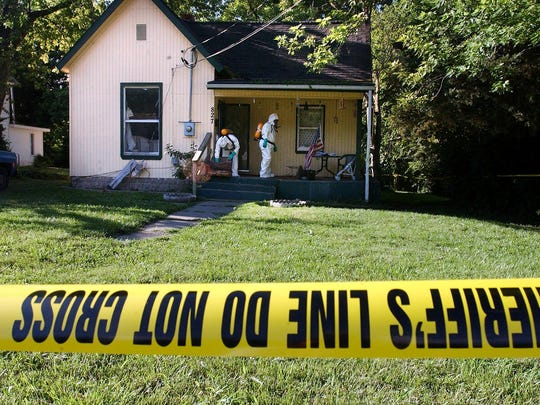 In this June 2004 photo, undercover officers from the Greene County Sheriff's Office remove hazardous items from a house where a meth lab was discovered. In recent years, more meth is imported from Mexico than produced in local meth labs, but the drug itself is no less of a threat.