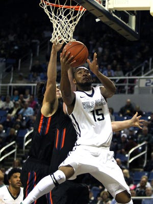 Wolf Pack guard D.J. Fenner drives against Boise State last season. The teams face off with first place on the line Wednesday.