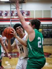 Ballinger's Ty Sensabaugh tries to shoot as Wall's