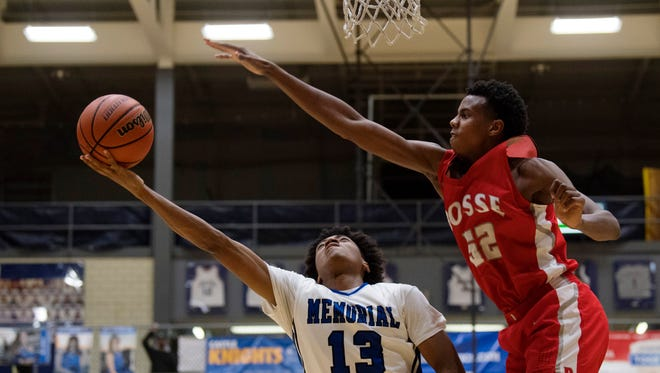 Memorial's Dylan Penn (13) shoots for two points over Bosse's Kiyron Powell (52) during their SIAC semifinal tournament game at Castle High School Thursday night.