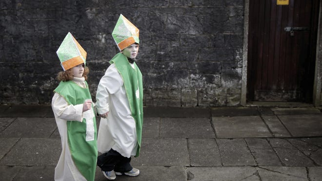 Costumed children make their way to the 2013 St. Patrick's Day parade in Limerick, Ireland. Genealogical research website Ancestry.com is making 10 million Catholic parish records from Ireland available online for free to help people trace their Irish heritage.