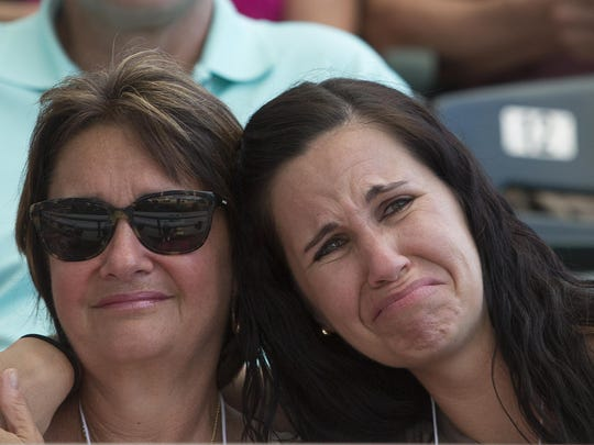 Sue Sommer, the wife of the late Jeff Sommer, is hugged by her daughter, Jennie West, at the fifth annual News-Press All-Area Banquet on Wednesday at Hammond Stadium.