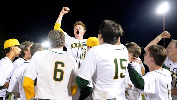 Reynolds' Josh Dotson jumps into the air as he celebrates