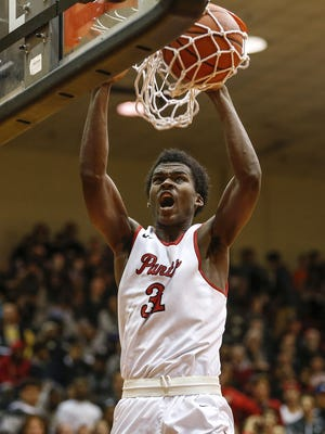 North Central Panthers Kris Wilkes (31) dunks against the Lawrence North Wildcats in the second half during their IHSAA 4A sectional final basketball game at North Central High School on Saturday, March 4, 2017.