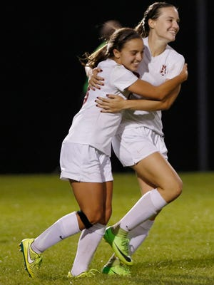 Kassidy Crowe of McCutcheon celebrates with Riley Nicol after her gola late in regulation against Lafayette Jeff in the girls soccer sectional Tuesday, October 3, 2017, at Harrison High School. Crowe had a hat trick as McCutcheon defeated Jeff 5-1.