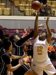Midwestern State's Chelsea Adams shoots over West Texas
