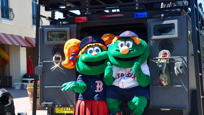 Red Sox mascots Tessie and Wally explore the Lee County Sheriff's armored vehicle during Celebrate Estero at Miromar Outlets March 18.