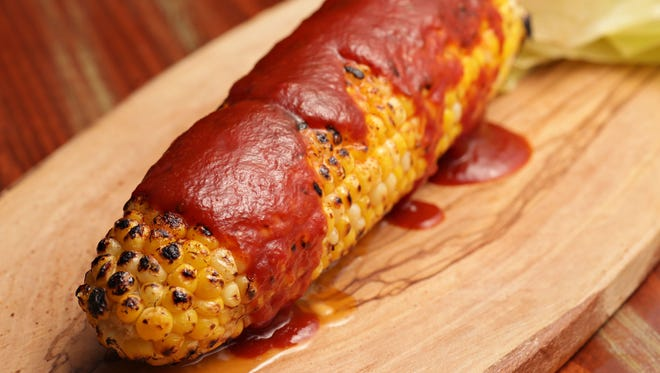Bryan's BBQ style corn on the cob with smoked brisket butter and BBQ sauce by chef Bryan Dooley.