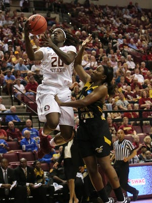 Florida State forward Shakayla Thomas is fouled by Alabama State defender Brittney Smith as she attempts a shot during the first half of a women's college basketball game in the first round of the NCAA tournament in Tallahassee, Fla., Saturday March 21, 2015. (AP Photo/Steve Cannon)