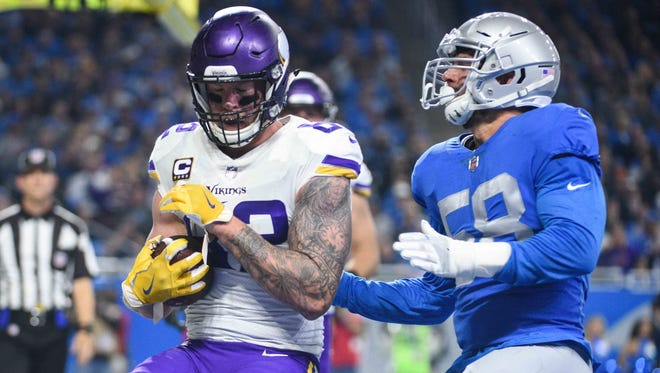 Minnesota Vikings tight end Kyle Rudolph (82) scores a touchdown during the first quarter against the Detroit Lions at Ford Field.
