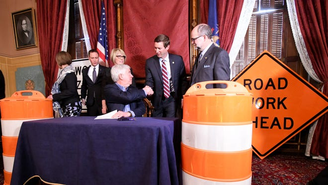 Gov. Rick Snyder earlier in 2018 signed a supplemental funding bill that plowed $175 million into road repairs.