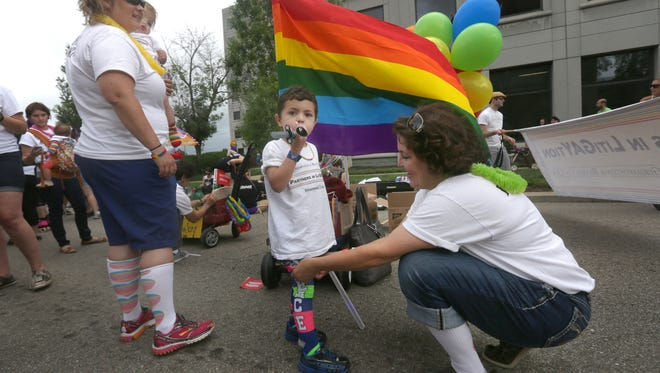 The Yorksmith family – Pam and Orion, 1, along with Grayden, 4, and Nicole – prepares to walk in the 2015 Cincinnati Pride Parade.
