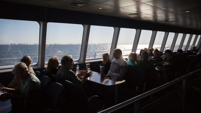 Guests pass the time aboard the Key West Express, which includes a full-service bar and food options to choose from.