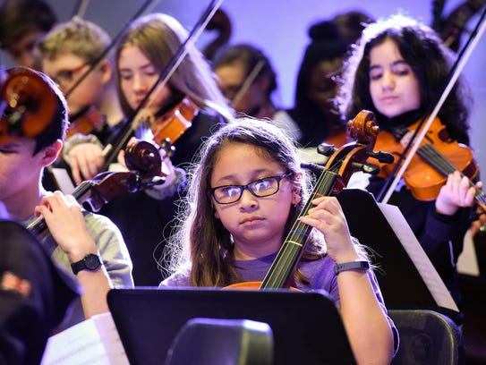 Musicians from area school work with Emmy-winning composer