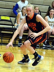 Beech High freshman forward Kendra Mueller drives to