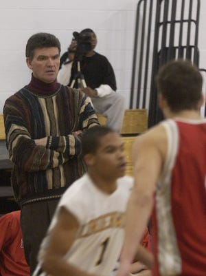 Ron Wister keeps an eye on the action from this game back in 2007. After 27 seasons, he has stepped down as the boys' basketball coach at Haddon Township.