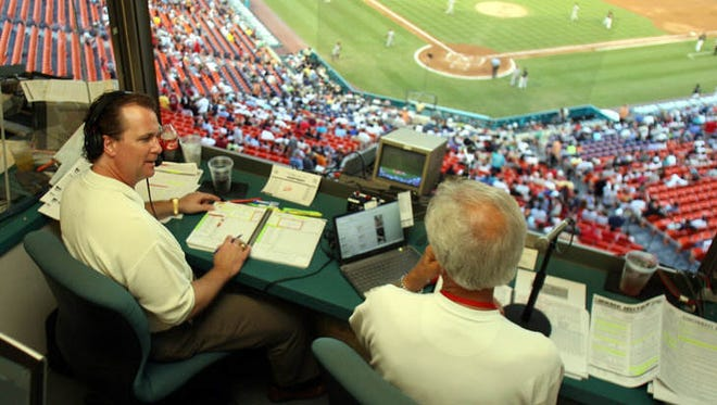 2007-present: Jeff Brantley, left, talks to (1974-present) Marty Brennaman, right, in between innings during the Cincinnati Reds game against the Florida Marlins at Dolphin Stadium July 19, 2007, in Miami.