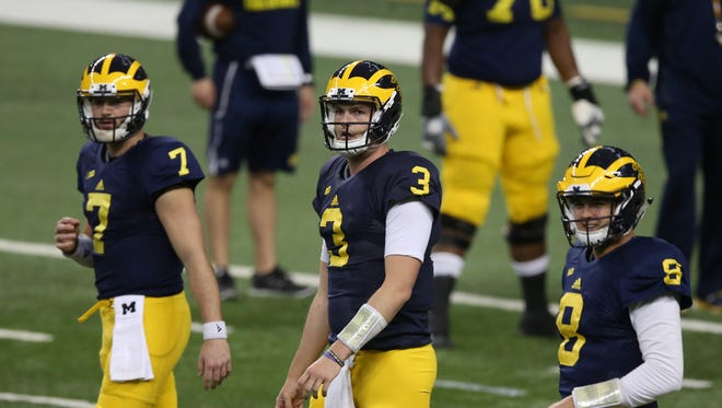 Michigan Wolverines QBs Shane Morris, Wilton Speight and John O'Korn go through drills during spring practice Saturday, March 26, 2016 at Ford Field in Detroit.