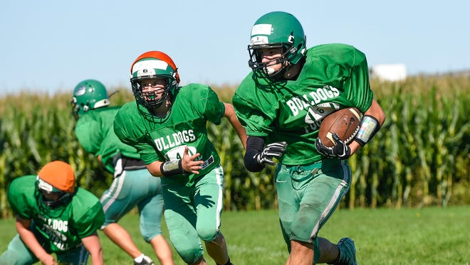Paynesville running back Jake Arnold runs with the ball during practice Tuesday, Aug. 22, in Paynesville.