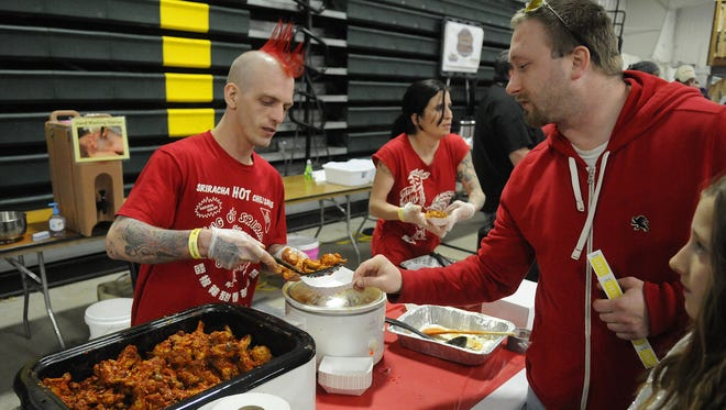 Dave Robasse and Cassie Groover serve up samples at a past Wingfest.