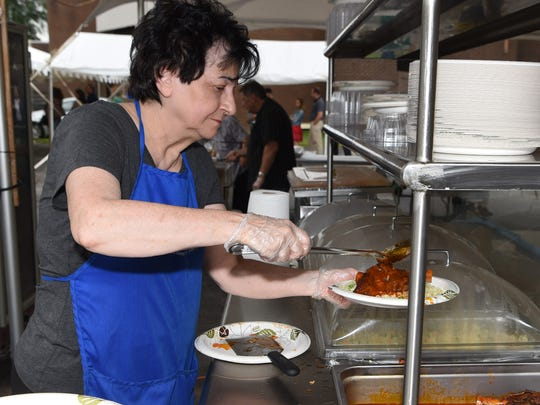 Volunteer Christine Mattes serves up some food at the annual Greek Festival, held at Kimisis Greek Orthodox Church in the Town of Poughkeepsie.