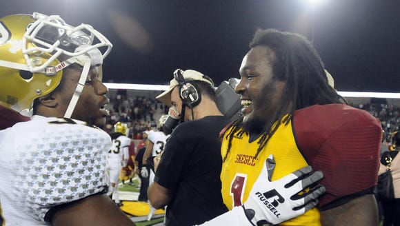 Alabama State and Tuskegee players meet after the Turkey