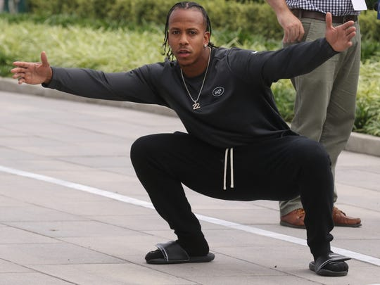 Jets cornerback Trumaine Johnson embraces New York as he is about to address the media.