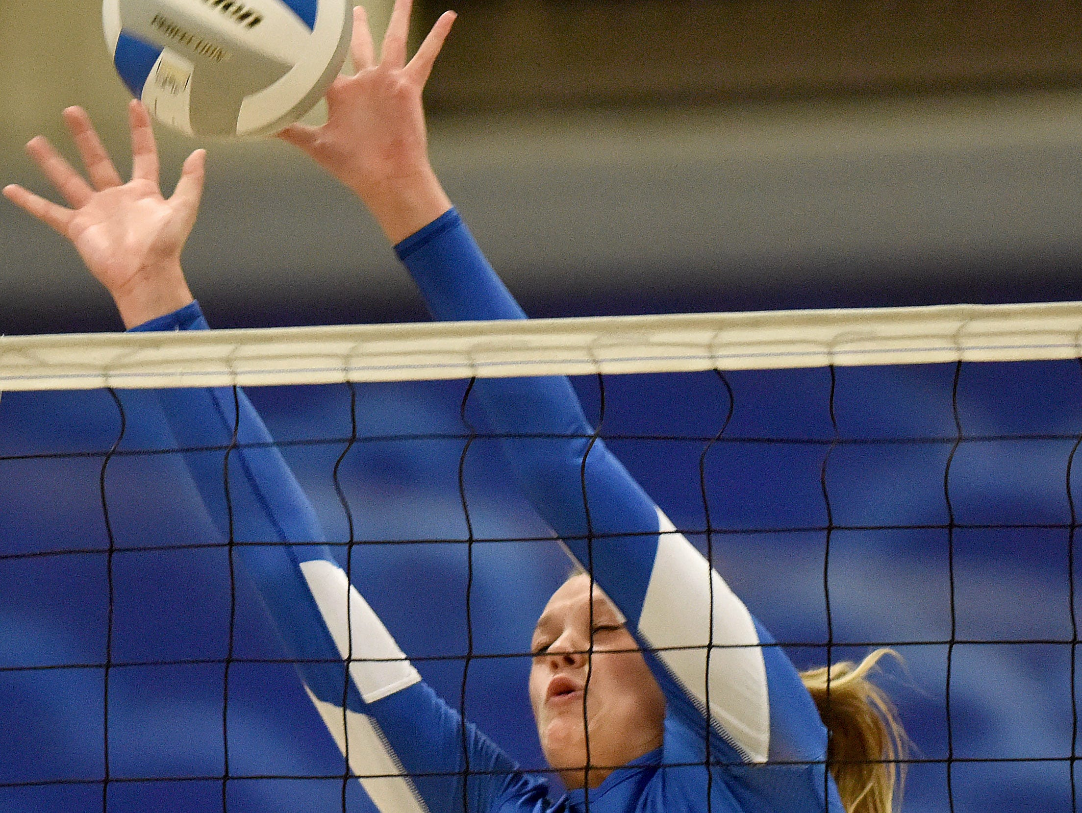 West Central's Ashlyn MacDonald blocks against Sioux Falls Christian during their game on Thursday.