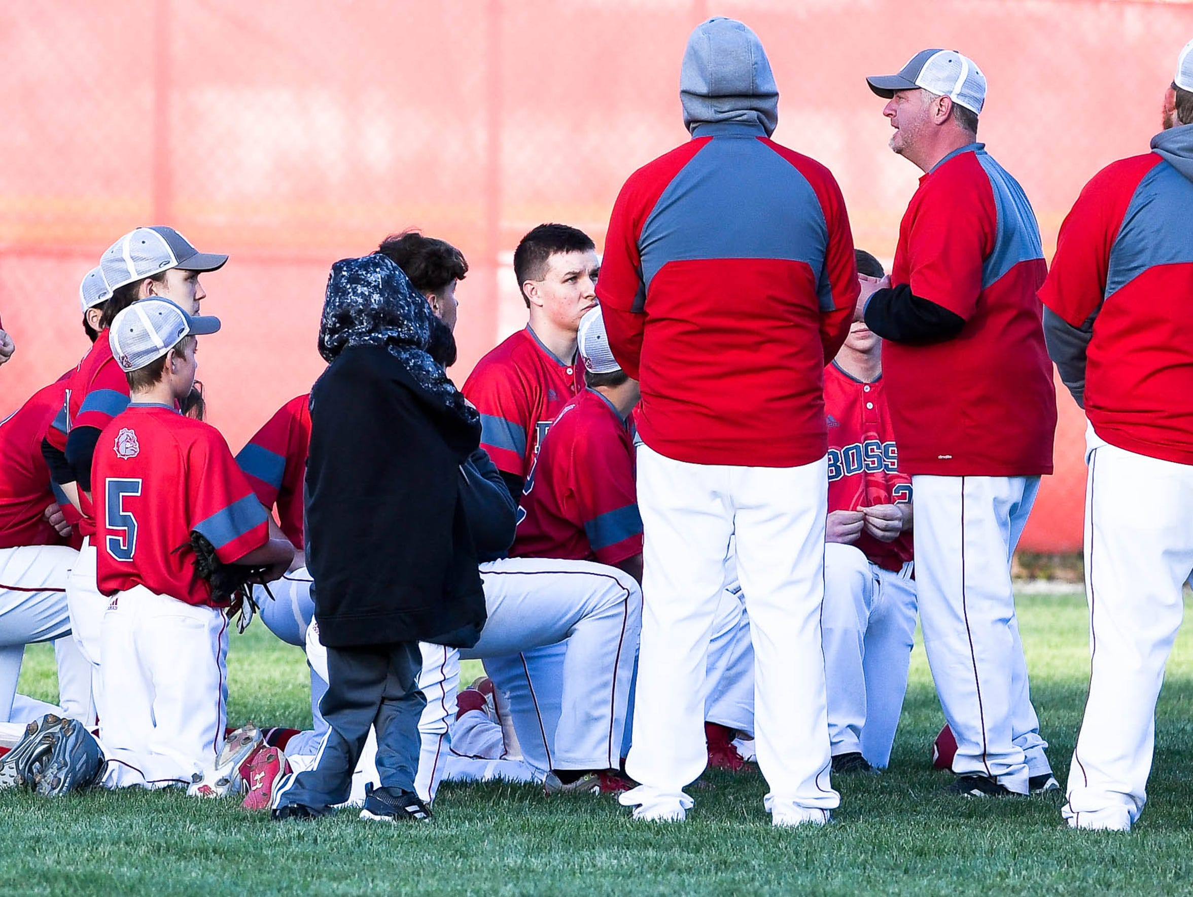 Bosse High School baseball coach Craig Shoobridge talks with his team after the Bulldogs lost to Castle on Thursday.