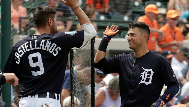 Jose Iglesias celebrates his home run with teammate Nicholas Castellanos in the fifth inning Sunday in Lakeland, Fla.