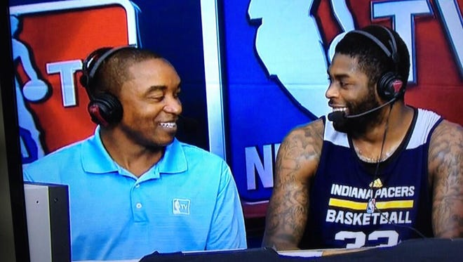 Former IU star and Pacers coach Isiah Thomas interviews Pacers Summer League participant Willie Reed (right).